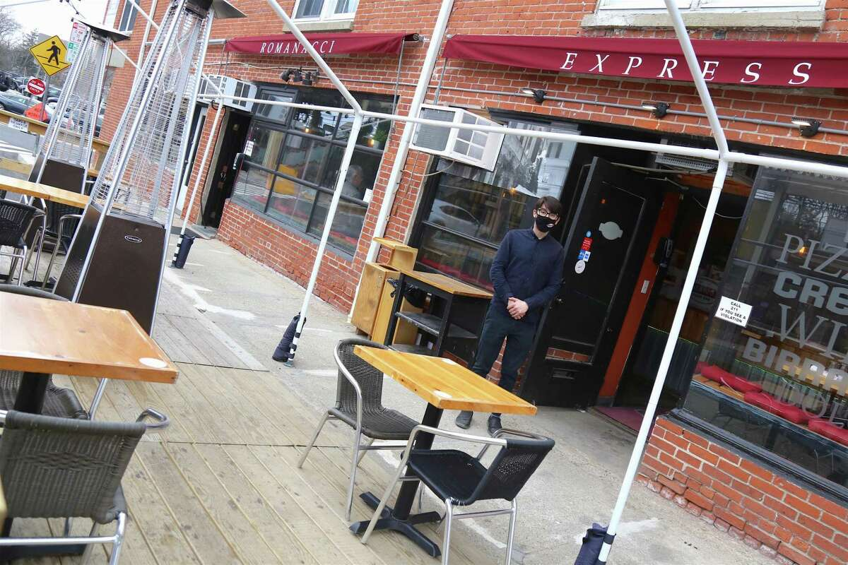 Julian Teichroeb, assistant manager of Romanacci Pizza Bar in Westport, said the outdoor seating created on the street has played a major role in helping keep the restaurant going.