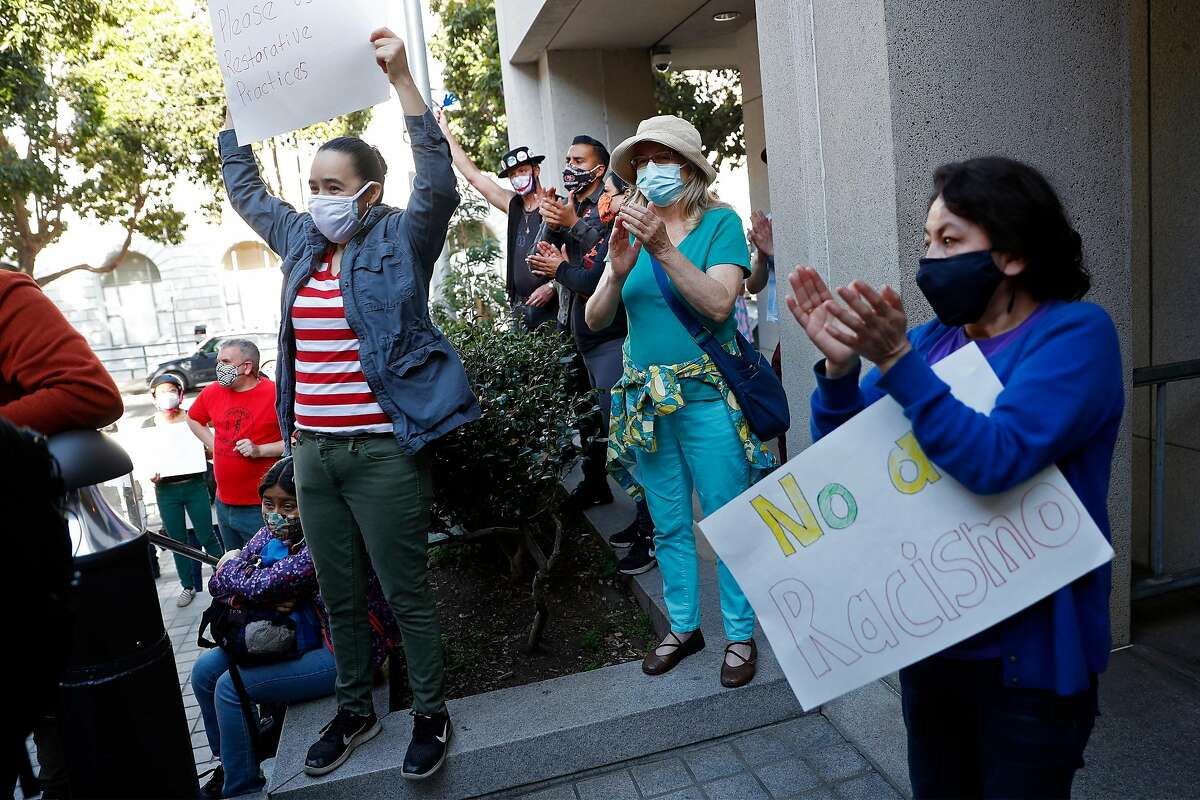 Supporters cheer during a rally for San Francisco school board member Alison Collins.