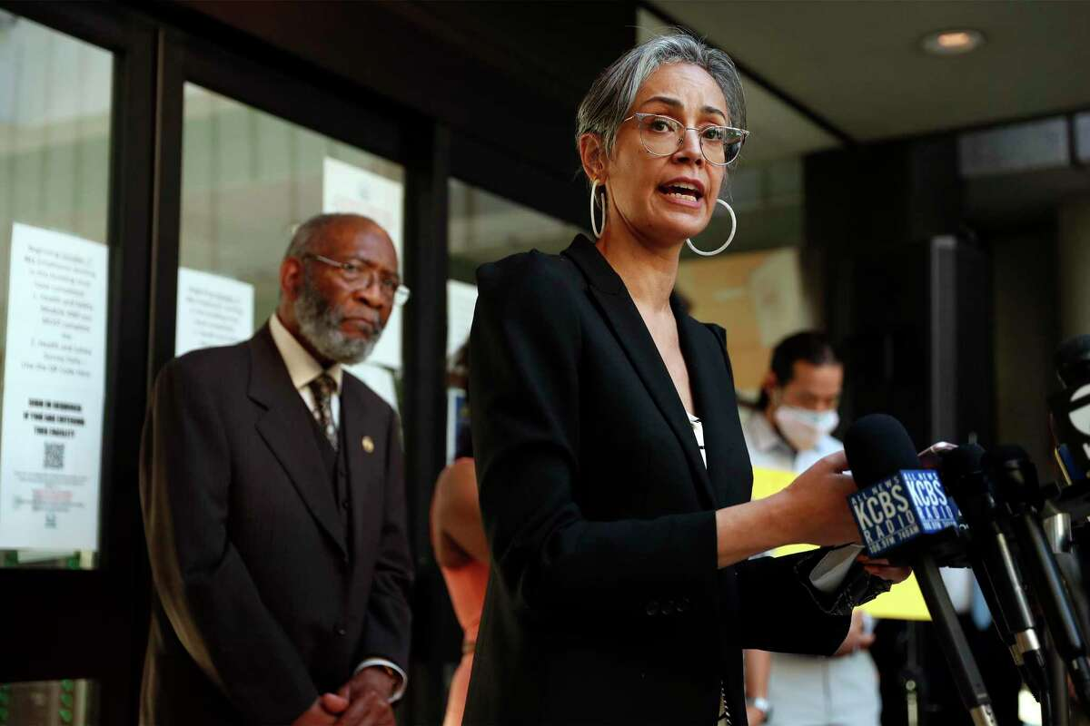 San Francisco School board Commissioner Alison Collins speaks during a rally at school district headquarters Wednesday.