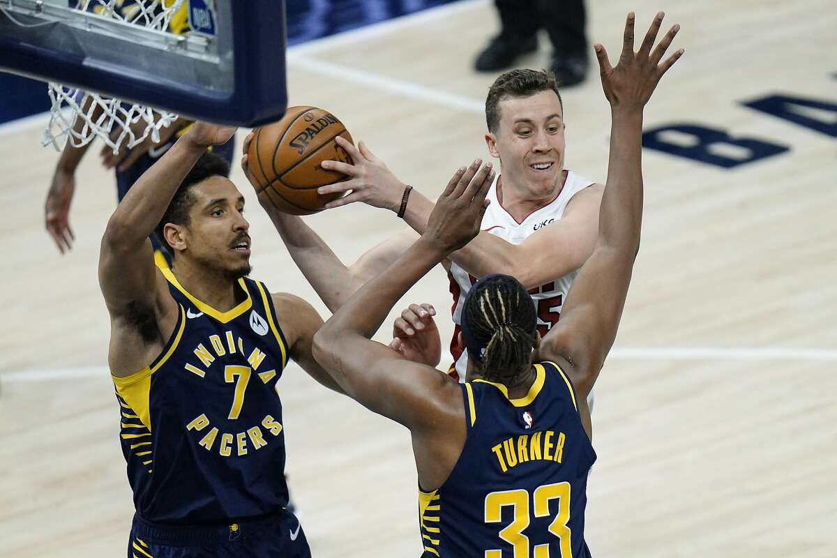 Heat guard Duncan Robinson (back right) scored a game-high 20 points to go with eight rebounds and four assists.