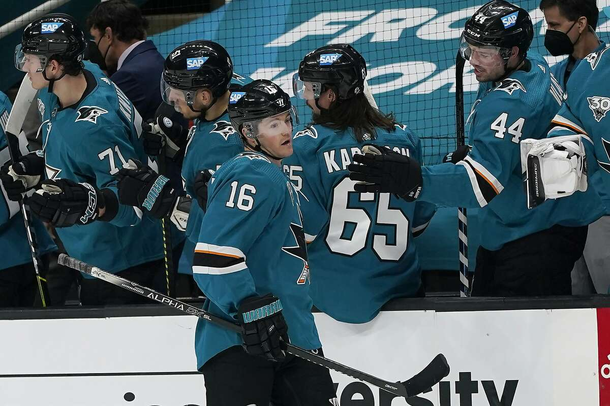 San Jose Sharks center Ryan Donato (16) is congratulated after scoring against the Minnesota Wild during the second period of an NHL hockey game in San Jose, Calif., Wednesday, March 31, 2021. (AP Photo/Jeff Chiu)