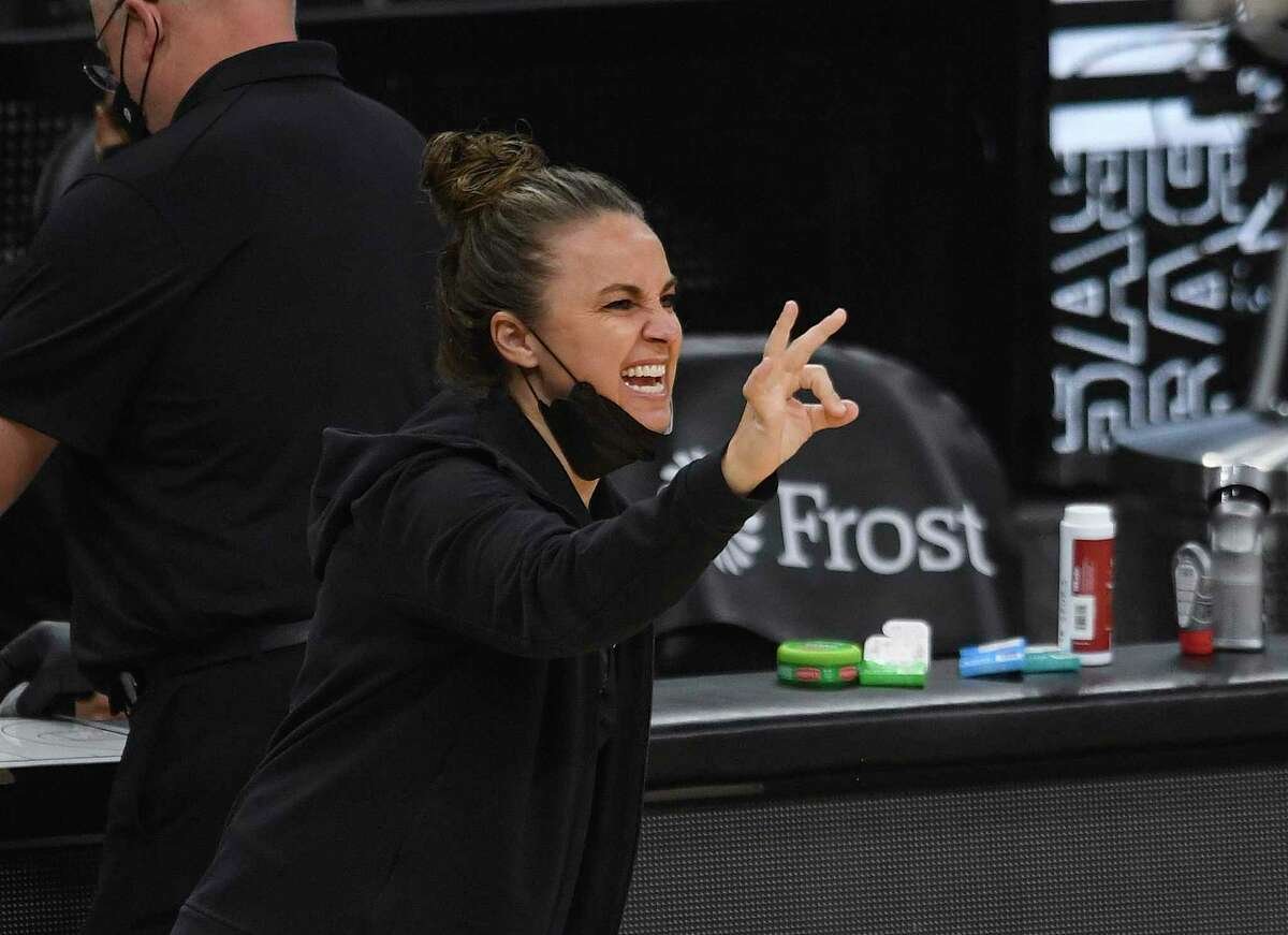 San Antonio Spurs assistant coach Becky Hammon signals to her players on the court during NBA action against the Sacramento Kings in the AT&T Center on Wednesday, March 31, 2021.