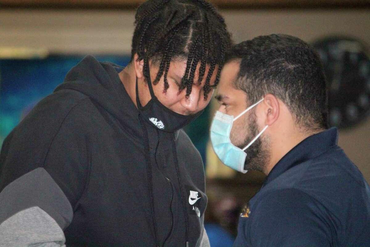 Baldwin bowling coach Duane Roberts (right) talks with Jalik Hawkins during a regular-season match. (Star file photo)