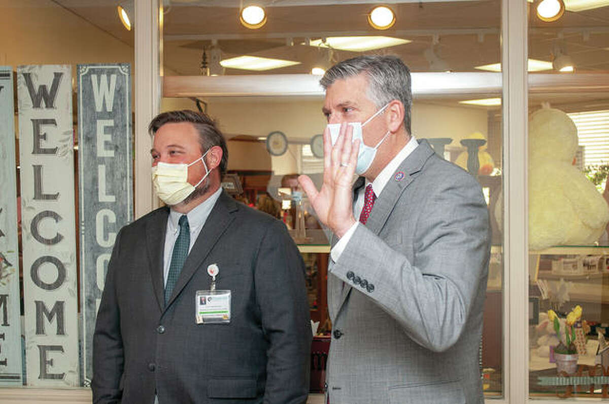 Passavant Area Hospital President Dr. Scott Boston (left) stands Wednesday morning with U.S. Rep. Darin LaHood, R-IL, as LaHood toured Morgan County Health Department's vaccination site at the hospital.