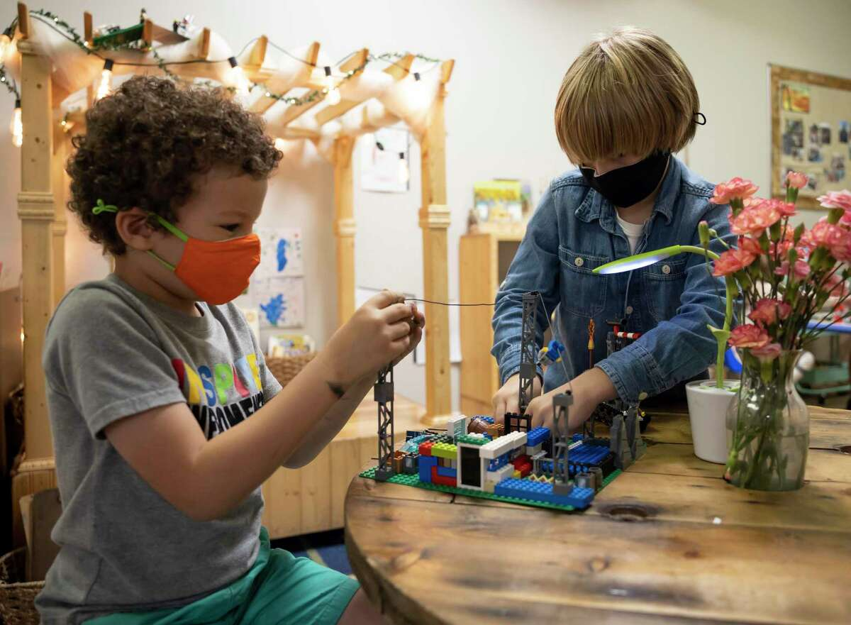 Cormac, left and Simon share building blocks at the Discovery School of Innovation in The Woodlands, Thursday, Sept. 24, 2020. The new school opened this year and plan to expand enrollment in the future.