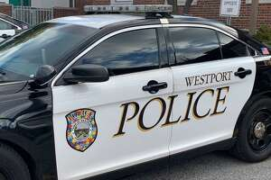 A Westport Police Department patrol car has an Autism Awareness Door with an Autism puzzle piece logo, for Autism Awareness Month, which is the month of April.