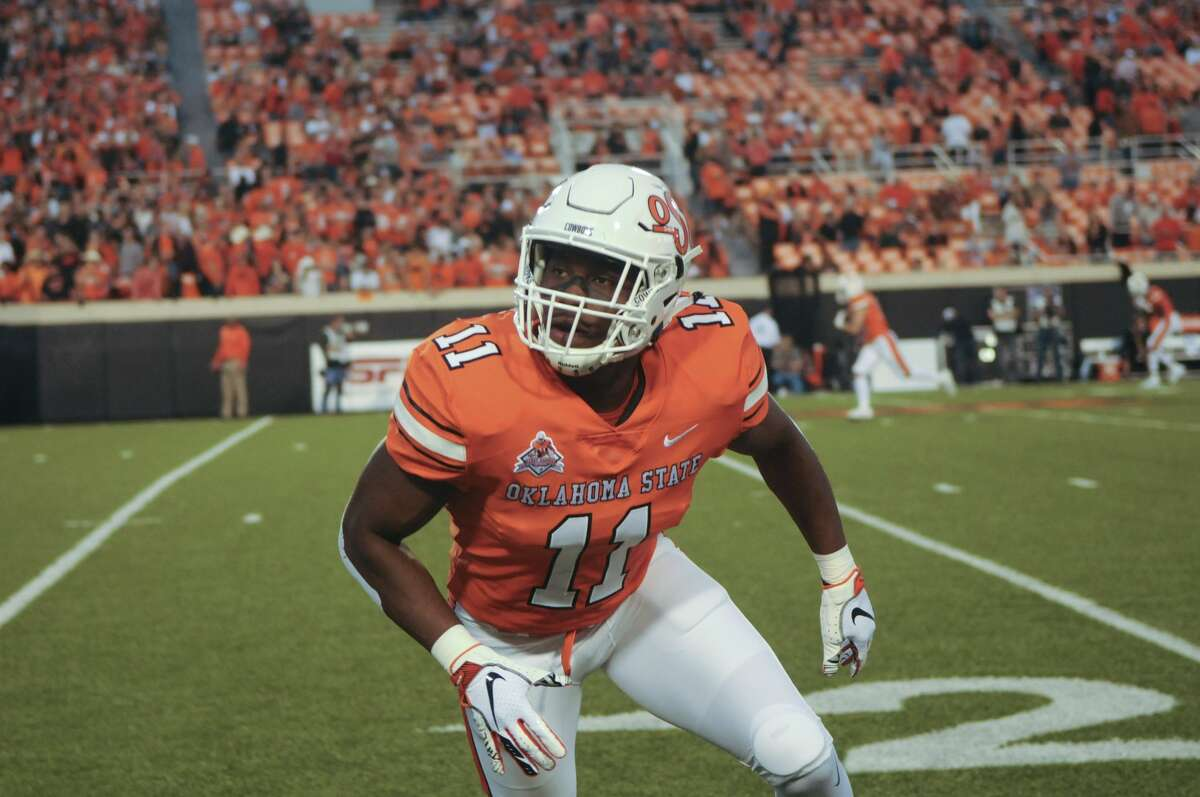 Oklahoma State linebacker Amen Ogbongbemiga warms up prior to an NCAA college football game in Stillwater, Okla., Saturday, Oct. 27, 2018. (AP Photo/Brody Schmidt)