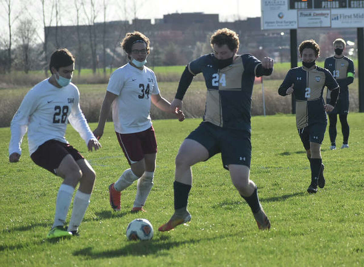 Father McGivney forward Thomas Hyten works past two EA-WR defenders during the second half.