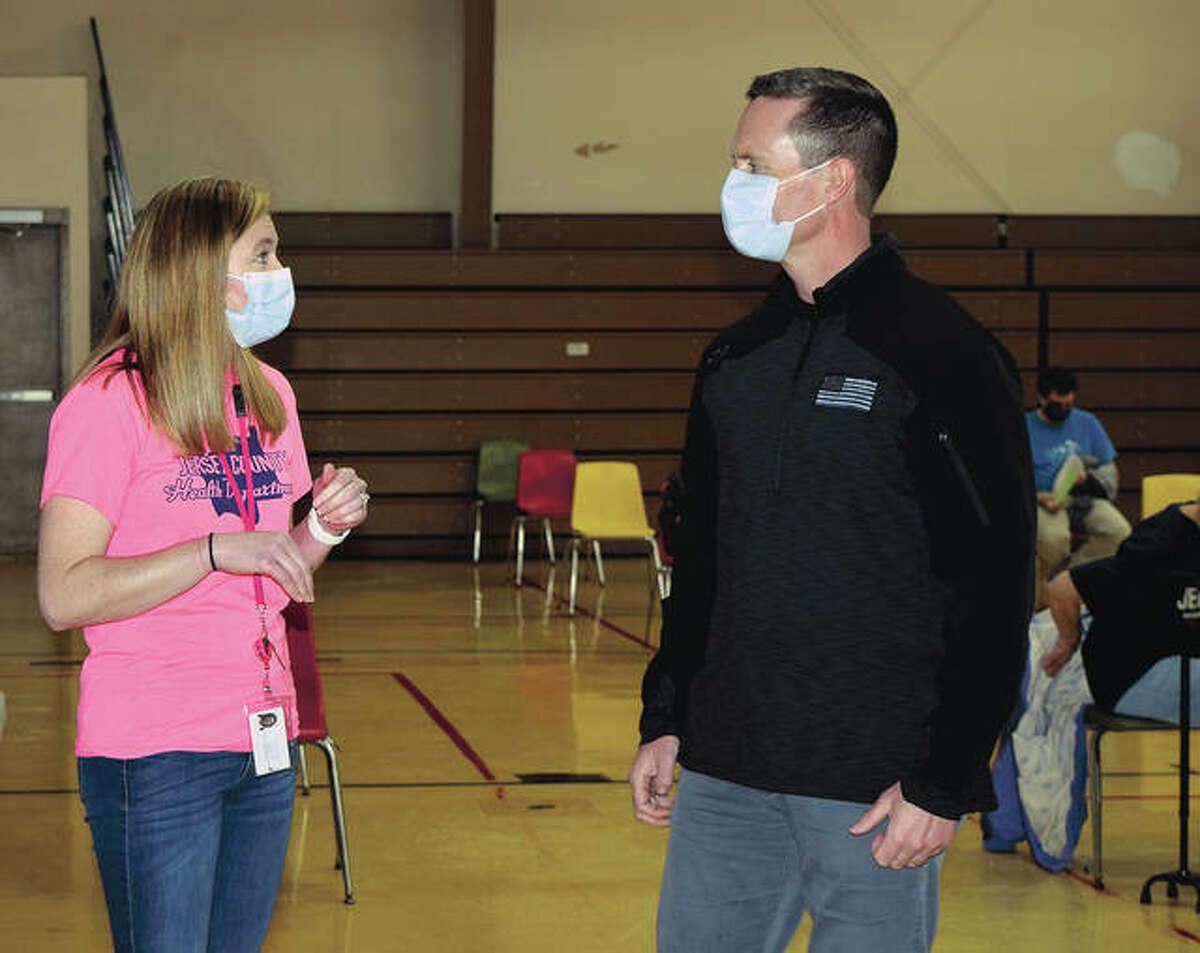 U.S. Rep. Rodney Davis talks to registered nurse Heidi Carter during a visit to a vaccination site in Jerseyville.