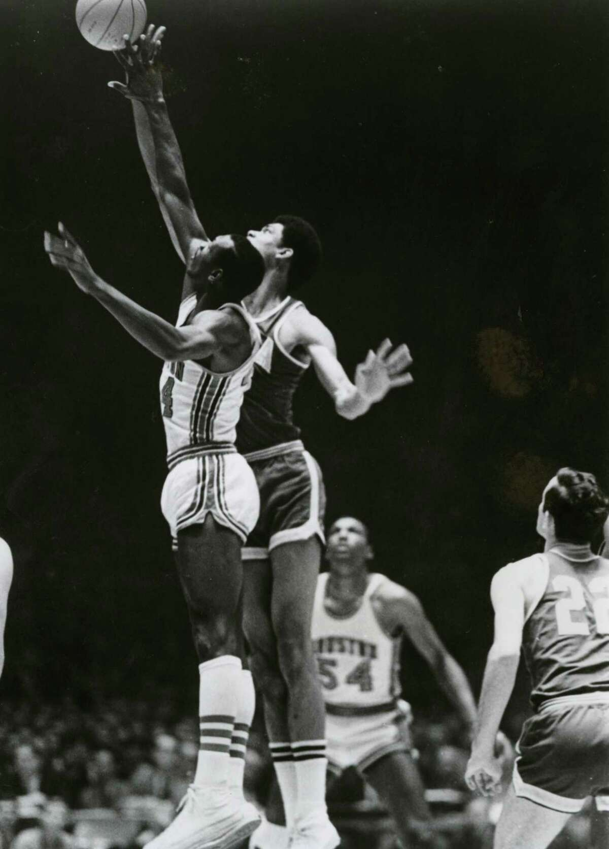 Elvin Hayes and Lew Alcindor get the 'Game of the Century' started with a jump ball in 1968.
