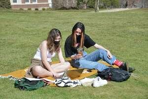 Wesleyan University students enjoy spring break in late March on campus in Middletown.