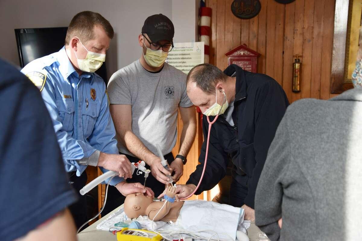 (From left) John Peddie, Chris Jeffries and Heath Darling are seen working on a neonatal resuscitation scenario.