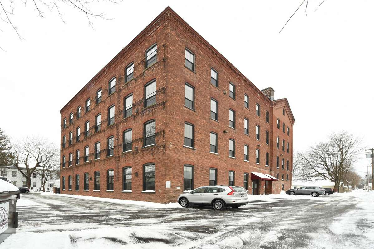 This week's selection is a condo in Troy. A former collar factory in a four-story brick building at 387 3rd Ave. was converted to condos. The listing is for a third-floor unit. It 1,847 square feet and has two bedrooms and two bathrooms. The living space is an open floor plan with 13-foot ceilings, hardwood floors and exposed brick painted white. Ownership comes with one parking space and a secure storage unit. Lansingburg schools. Homeowners association fee: $290 per month. Taxes: Approximately $3,200. List price: $189,900. Contact listing agent Michael Bushee with CYC Realty Management at 518-785-9461.