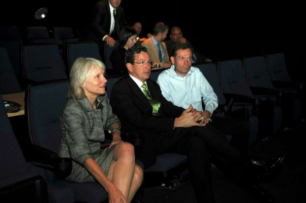 Former Connecticut Gov. Dan Malloy, center, in June 2011 at Blue Sky Studios in Greenwich, Conn., alongside Catherine Smith who led the Connecticut Department of Economic and Community Development during Malloy's administration; and Brian Keane, then chief operating officer of Blue Sky.