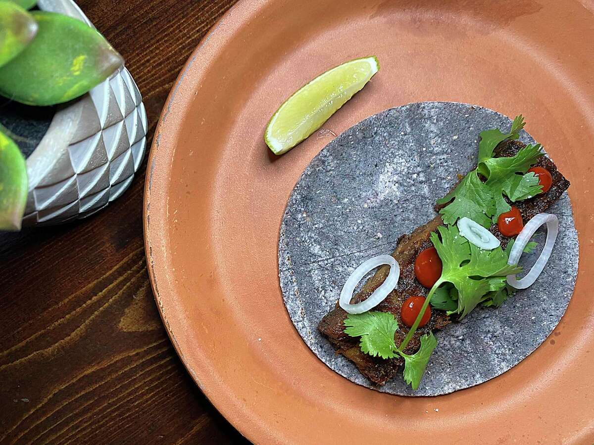 A taco made with braised suadero with chile mole was part of a multicourse menu at Kumo, the restaurant from Mixtli chefs Rico Torres and Diego Galicia that closed this week.