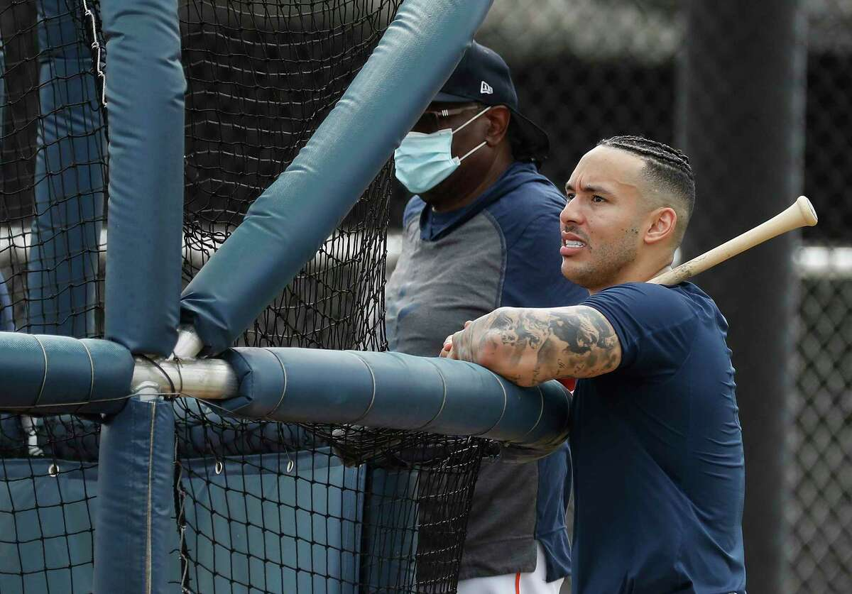 Houston Astros shortstop Carlos Correa with his new hairdo during spring training workouts for the Astros at Ballpark of the Palm Beaches in West Palm Beach, Florida, Friday, February 26, 2021.