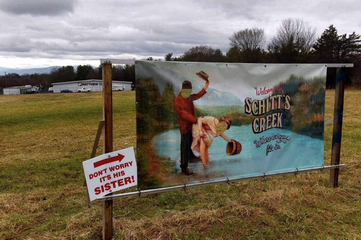 """A likeness of a welcome sign used in the sitcom """"Schitt's Creek"""" was put up as a novelty by the owners of Matthew Signs in front of their business on Thursday, April 1, 2021, on Route 9 in Stockport, N.Y. The sign sent one driver to the state Department of Transportation and the town, demanding its removal. (Will Waldron/Times Union)"""
