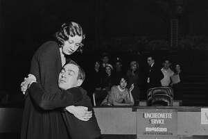 Marathon dancer Ann Lawanick struggles to carry her sleepy partner, Jack Ritof, in Chicago in this 1930 photo. (Photo by Keystone-France/Gamma-Keystone via Getty Images)