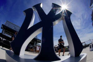 A giant New York Yankee logo greets baseball fans inside George M. Steinbrenner Field before a spring training exhibition baseball game between the New York Yankees and the Detroit Tigers in Tampa, Fla., Friday, March 5, 2021.