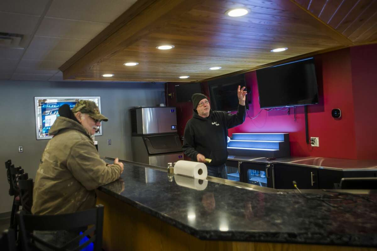 Red Oak Restaurant owner Kevin Ayotte, right, points out new features at the bar area Thursday afternoon, April 1, 2021 in Sanford. The restaurant will reopen again to customers this Sunday, April 4 for Easter brunch and dinner after being closed for nearly a year due to the flooding last May decimating the building. (Katy Kildee/kkildee@mdn.net)