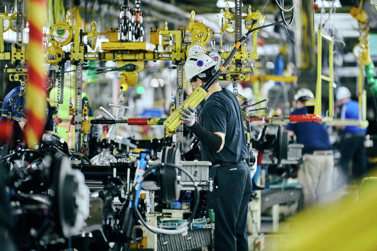 Employees work on the assembly lines at Toyota's manufacturing plant here. Supporters of Chapter 313 agreements say they bring new jobs, investment and taxes to Texas.