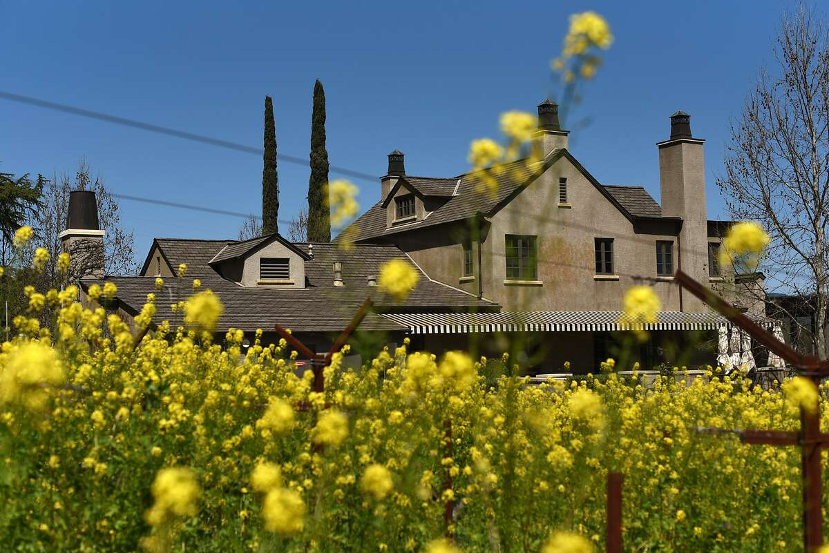 The Steckter House, a historic building where the Staglin family hosts wine tastings, adjacent to its vineyard.