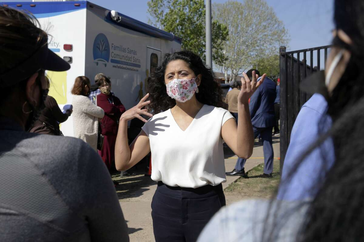 Harris Co. Judge Lina Hidalgo, center, talks with area residents in line for the vaccine at Pitner Pocket Park Thursday, Apr. 1, 2021 in Houston, TX. Hildago received her first dose of the Moderna vaccine during the visit.