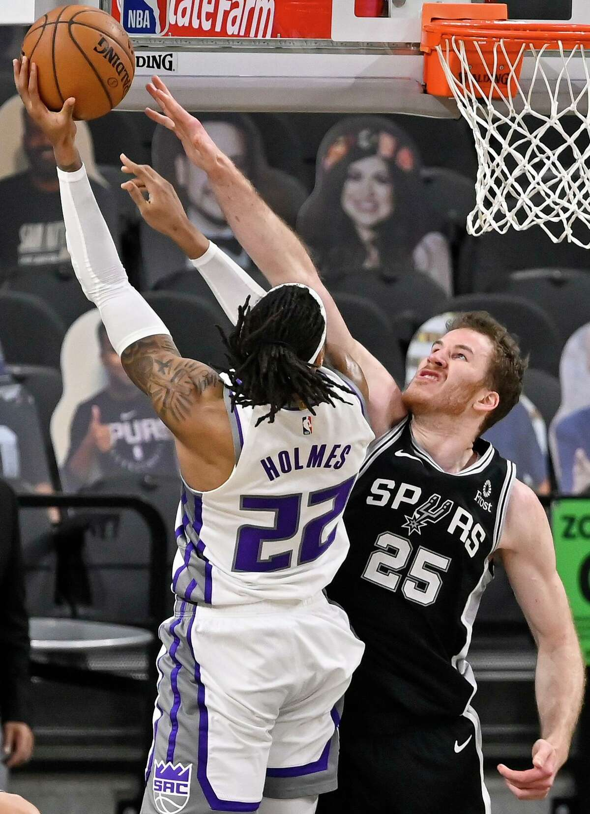 Sacramento Kings' Richaun Holmes (22) shoots against San Antonio Spurs' Jakob Poeltl during the first half of an NBA basketball game, Wednesday, March 31, 2021, in San Antonio. (AP Photo/Darren Abate)