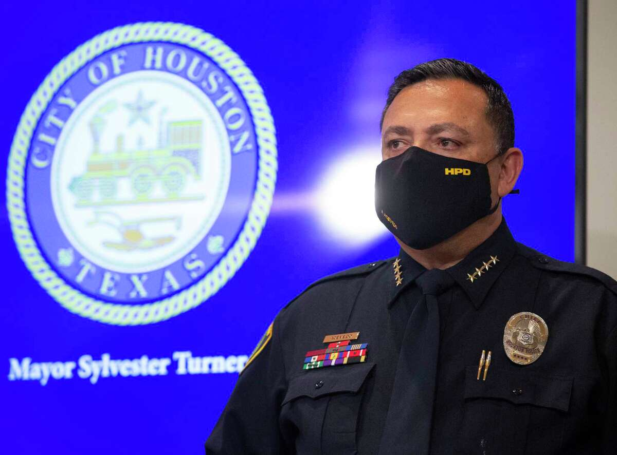 Houston Police Chief Art Acevedo watches Houston Mayor Sylvester Turner announcing he has selected Executive Assistant Chief Troy Finner to be the next chief of the department during a press conference Thursday, March 18, 2021, at Houston City Hall in Houston. Acevedo is leaving Houston to be the chief of Miami Police Department.