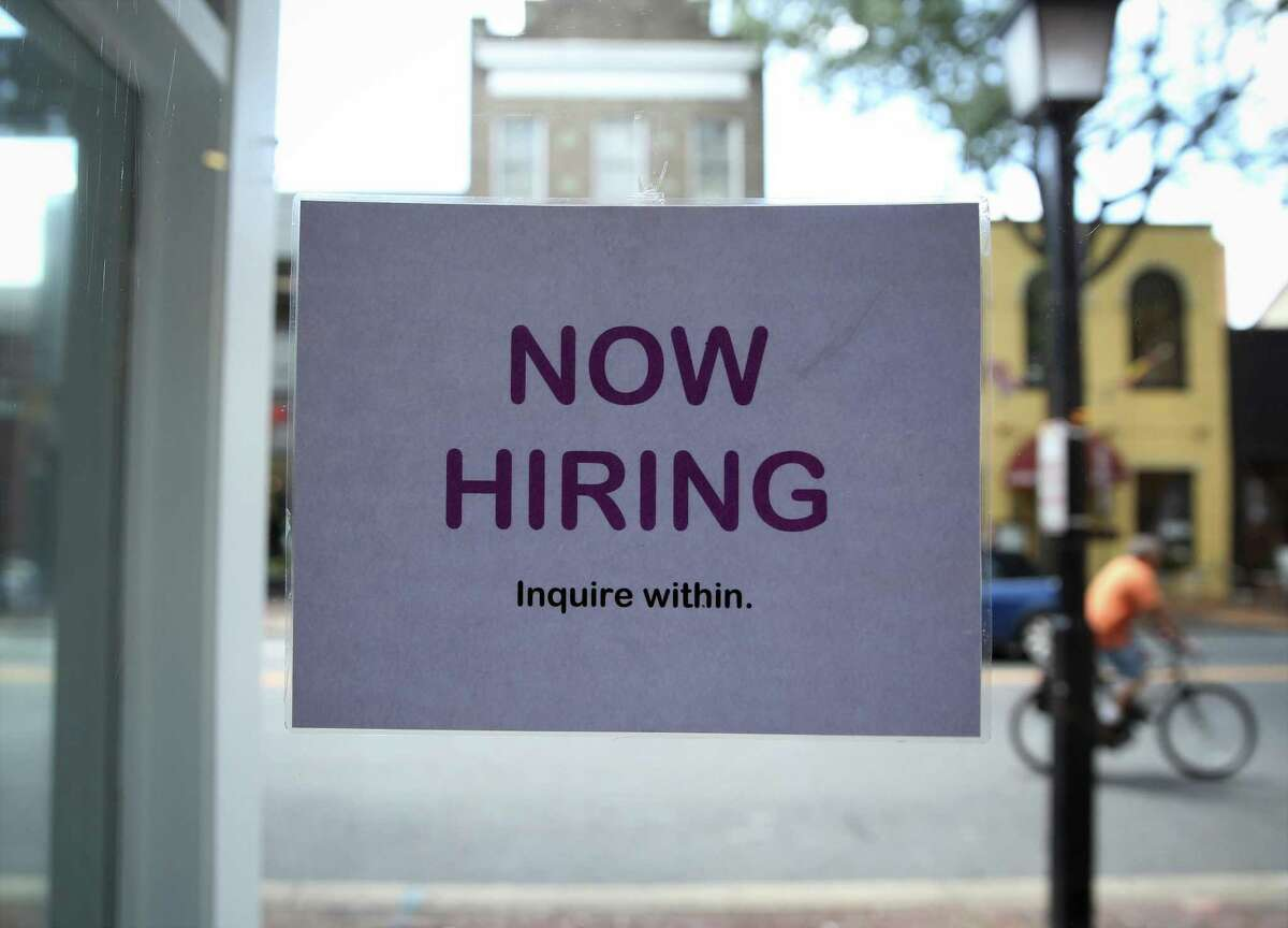 ALEXANDRIA, VA - JULY 05: A hiring sign is seen July 5, 2013 in Old Town Alexandria, Virginia. The Labor Department reported that U.S. economy has added 195,000 jobs in June with the unemployment rate remained unchanged at 7.6 percent. (Photo by Alex Wong/Getty Images)