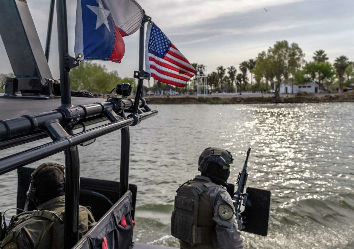 """FILE: A Texas Department of Public Safety (DPS) boat patrols along the Rio Grande on March 23, 2021 near Mission, Texas. Texas DPS troopers are taking part in Operation Lone Star in supporting U.S. Border Patrol agents to """"deny Mexican Cartels and other smugglers the ability to move drugs and people into Texas."""" A surge of immigrants, including unaccompanied minors crossing into the United States from Mexico is overcrowding processing and detention centers in south Texas. (Photo by John Moore/Getty Images)"""