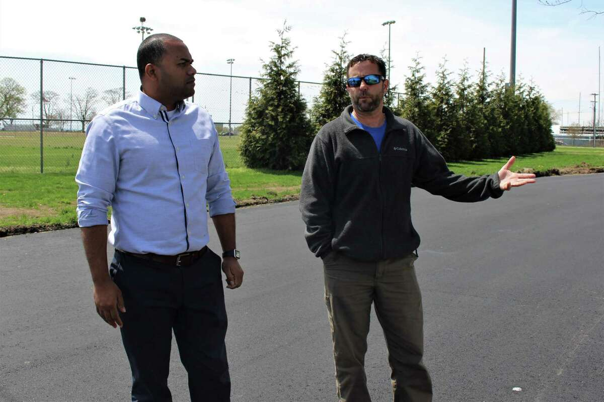 Ken Hughes, the superintendent of parks and public property for Norwalk, and Nick Roberts, the city's new recreation and parks director explain on Thursday, April 25, 2019, how the new beach parking system will work for 2019.