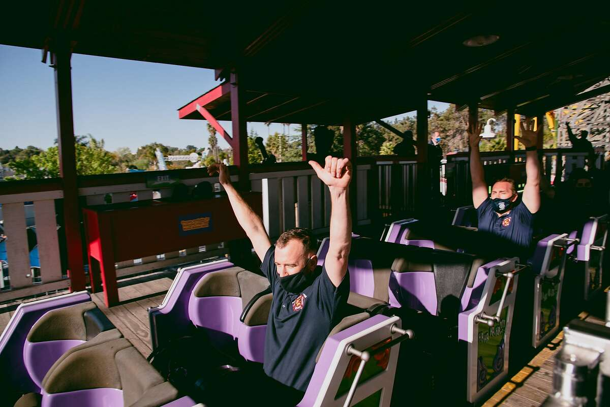 Vallejo firefighters Brett Bullock and Stephen Kay prepare to ride the first roller coaster to reopen in over a year at Six Flags Discovery Kingdom in Vallejo, Calif., on Thursday, April 1, 2021. To recognize frontline workers, Six Flags invited medical staff and first responders to ride before the park reopened its attractions to the public for the first time during the COVID-19 pandemic. SIXFLAGS0402