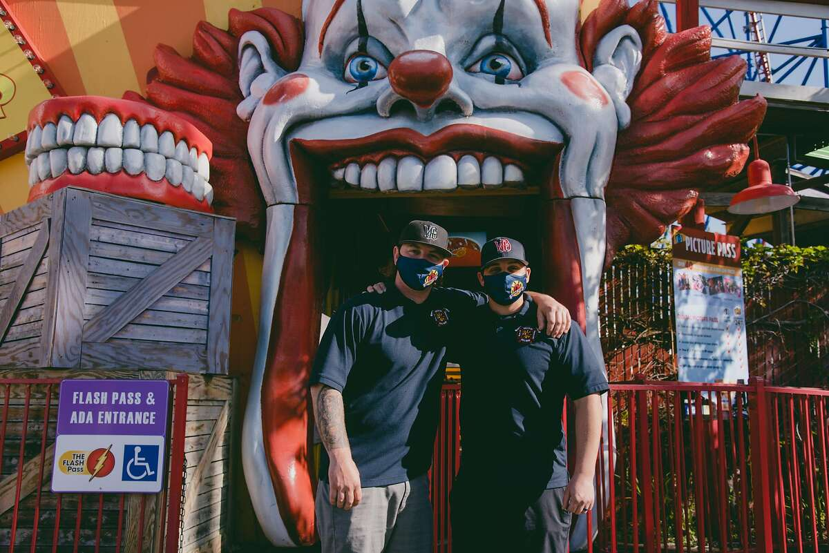 Vallejo firefighters Stephen Kay, left, and Kevin Reustle pose for a portrait outside of The Joker ride at Six Flags Discovery Kingdom in Vallejo, Calif., on Thursday, April 1, 2021. Medical staff and first responders were welcomed inside the park prior to it reopening attractions for the first time in over a year since the beginning of the COVID-19 pandemic. SIXFLAGS0402