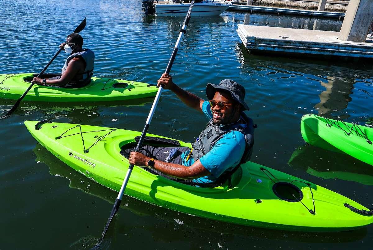 Julius Crowe Hampton, a Outdoor Afro leader, kayaks at Marina Bay Yacht Harbor in Richmond.