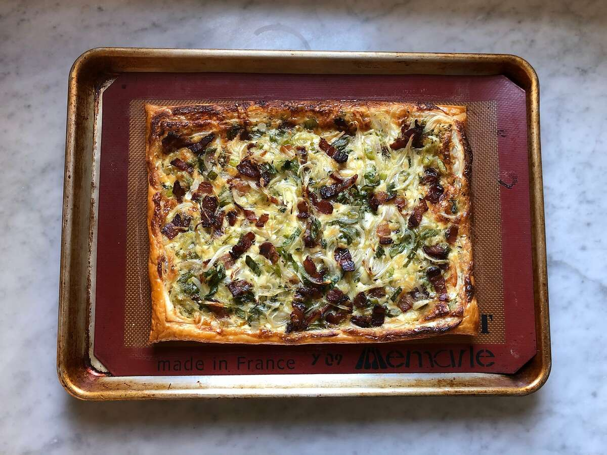 Spring onions, nutty cheese and bacon make a flavorful tart nestled in a buttery puff pastry.