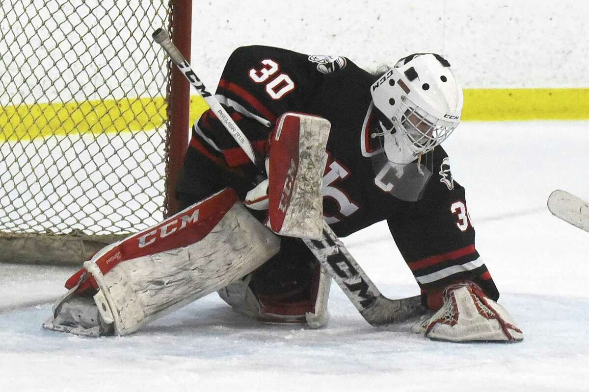 New Canaan goalie Blythe Novick covers the puck against Greenwich during a girls ice hockey game at Hamill Rink in Greenwich on Tuesday, Feb. 23, 2021.