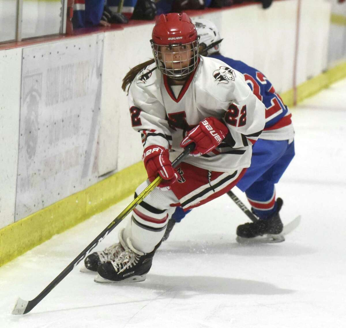 New Canaan's Grace Crowell (22) comes off the boards with the puck during the Rams' game against Fairfield in the FCIAC girls ice hockey semifinals at the Darien Ice House on Wednesday, Feb. 26, 2020.
