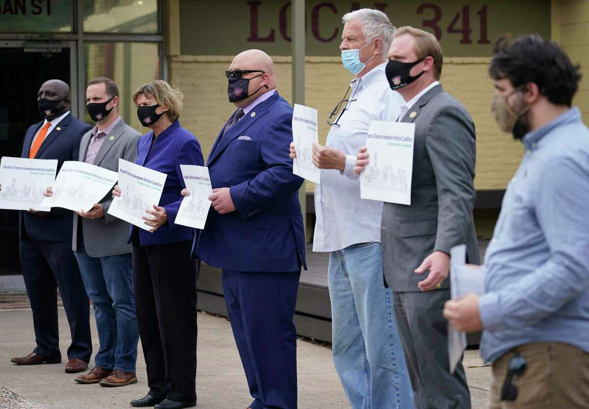 Supporters of a charter amendment to give City Council members more power to gets votes on items are shown during a media conference in October. The coalition announced it gathered the required number of signatures Thursday to get the item on the ballot.