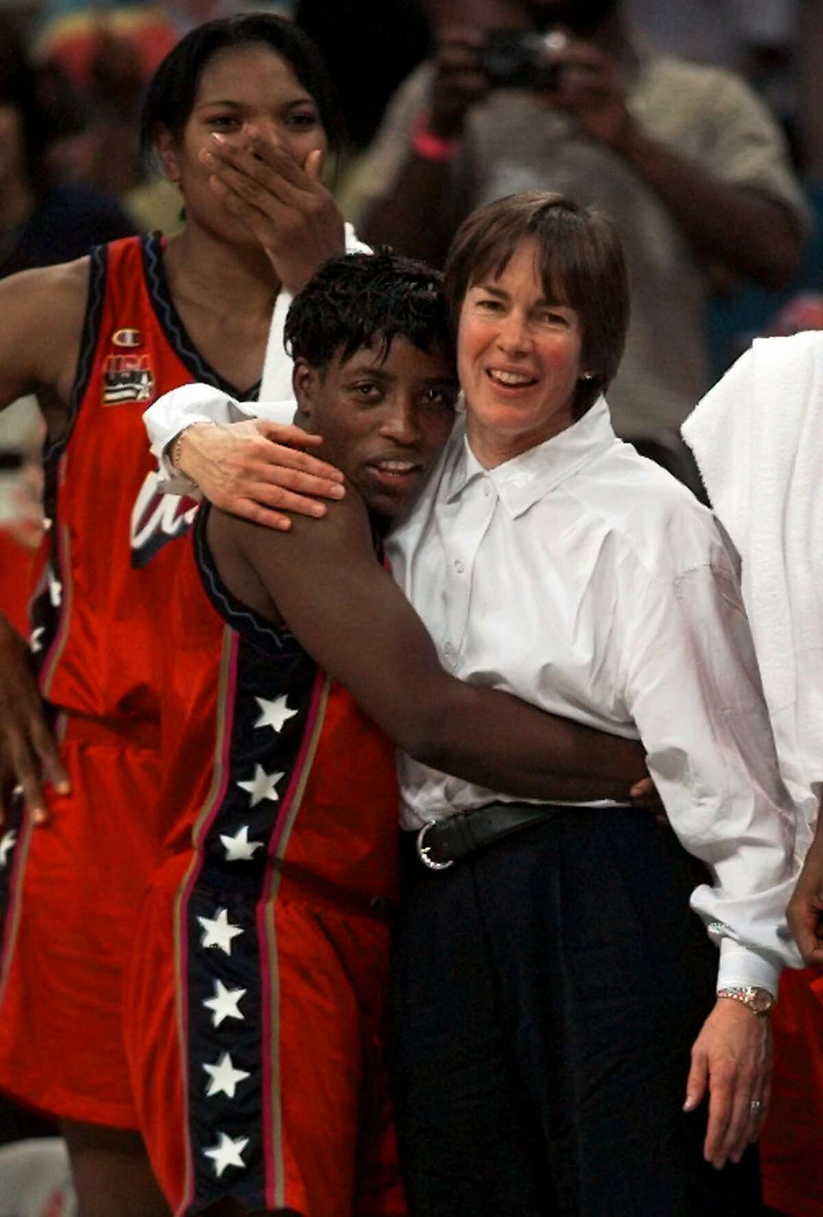 FILE - In this Aug. 4, 1996, file photo, USA women's head coach Tara VanDerveer, right, hugs Ruthie Bolton, as Venus Lacey watches the action on the court during the final moments of the Gold medal women's basketball game against Brazil at the Centennial Summer Olympic Games in Atlanta. There was much more at risk for the 1996 Olympic women's basketball team than just winning the gold medal when they took the floor against Brazil in Atlanta. (AP Photo/Eric Draper, File)