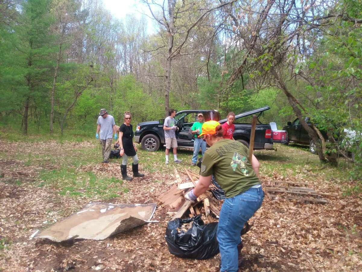 In this Feb. 2020 photo, volunteers from Dublin Heights Sports Clubremove litter from Manistee National Forest. The group recently announced plans for volunteers to assistwith cleanup efforts through the county's Adopt-A-Road program and are encouraging others to do so as well.(File Photo)