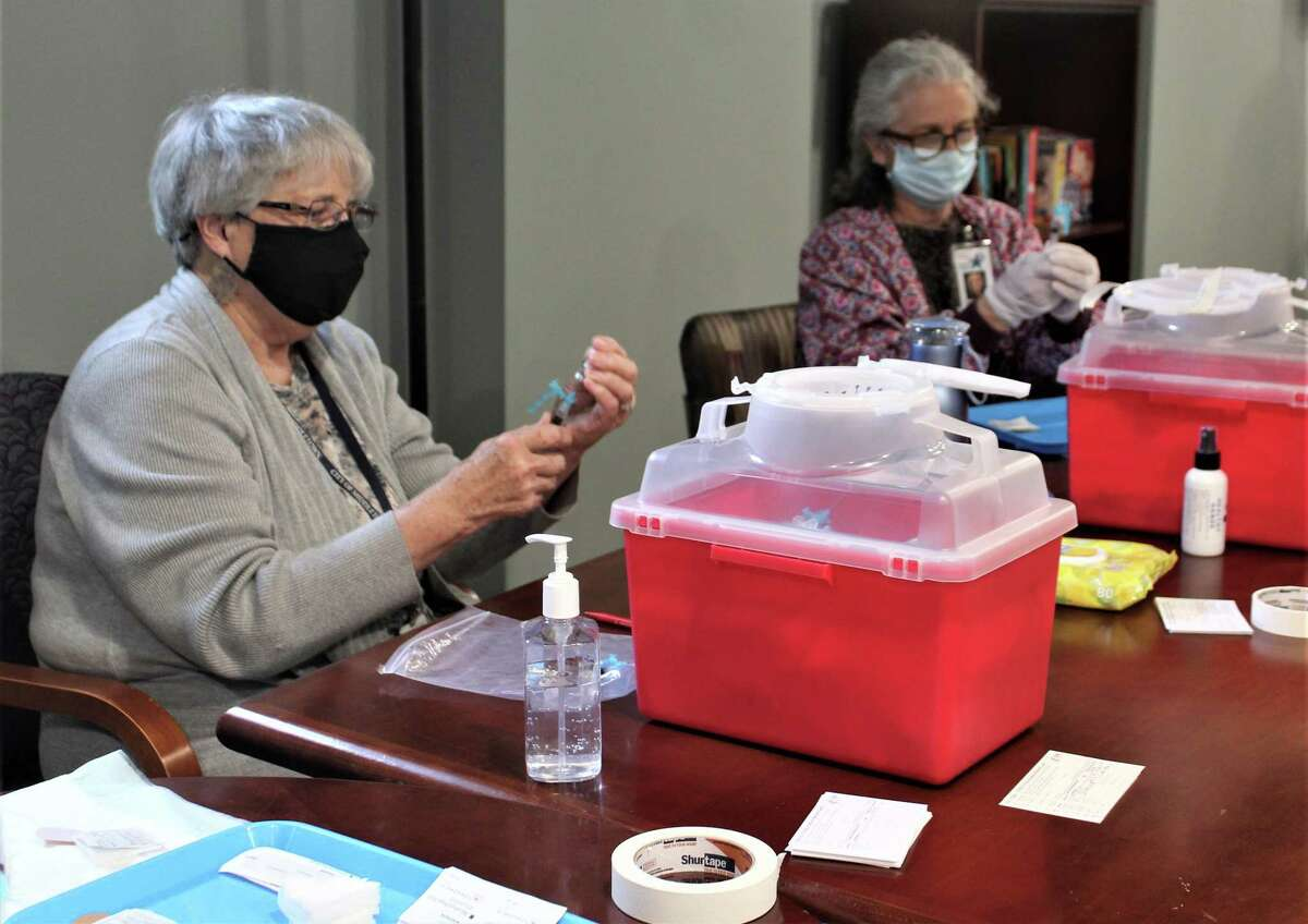Medical personnel administer the Johnson & Johnson COVID-19 vaccine at the Shepherd Home on Bow Lane in Middletown Thursday.