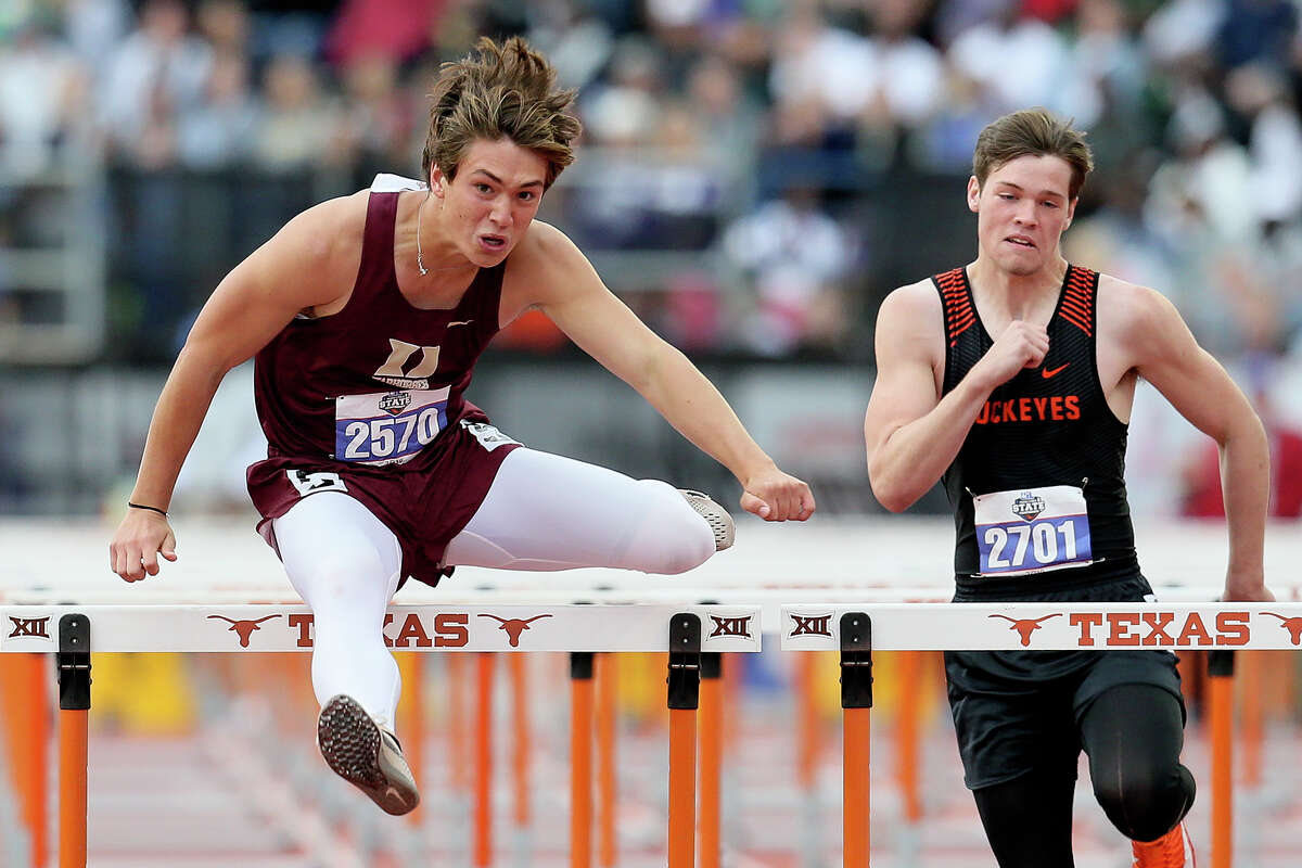 Devine's Quentin Zapata, left, clears the final hurdle in the 4A boys 110-meter hurdles during the UIL state track and field championships at Mike Myers Stadium in Austin on Saturday, May 11, 2019. Zapata won the event with a time of 13.84 seconds.