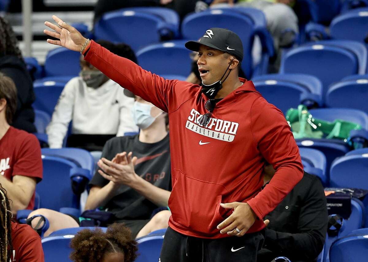 Seattle Seahawks quarterback Russell Wilson cheers on his sister Anna Wilson of the Stanford Cardinal in the first half against Missouri State in the Sweet 16 round of the NCAA Tournament.