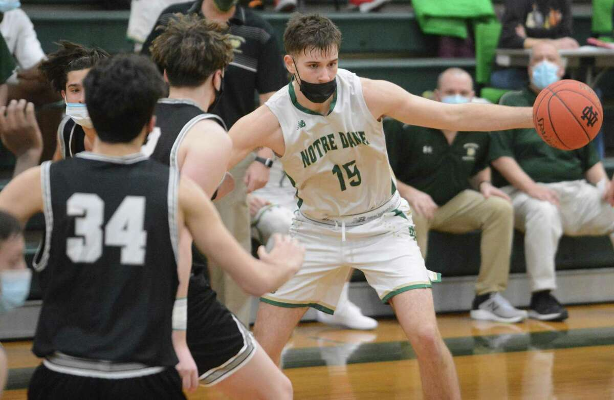 Notre Dame-West Haven's Ben Carroll handles the ball during a game against Xavier.