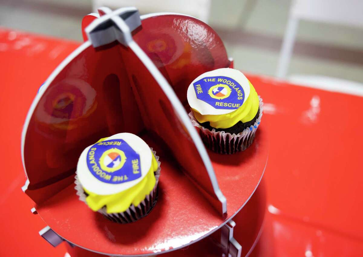 As seen, custom cupcakes are offered during a retirement party in honor of Deputy Fire Chief Jerry Bittner at the Woodlands Fire Department Administration and Station 1, Wednesday, March 31, 2021, in The Woodlands. Bittner served with the fire department for over 40 years before retiring.