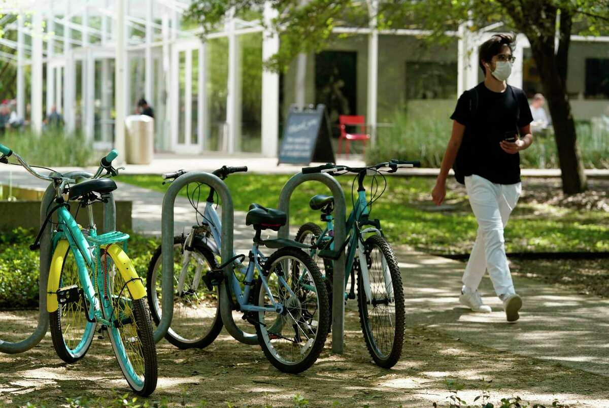 Bicycles are shown on the campus of Rice University near the Brochstein Pavilion Thursday, April 1, 2021 in Houston. Rice University has announced an expansion of its student body and its campus. The physical expansion on the college's 300 acres, will include a 12th residential college, a new engineering building, a building for the visual and dramatic arts, and a new student center that will largely replace the Rice Memorial Center.