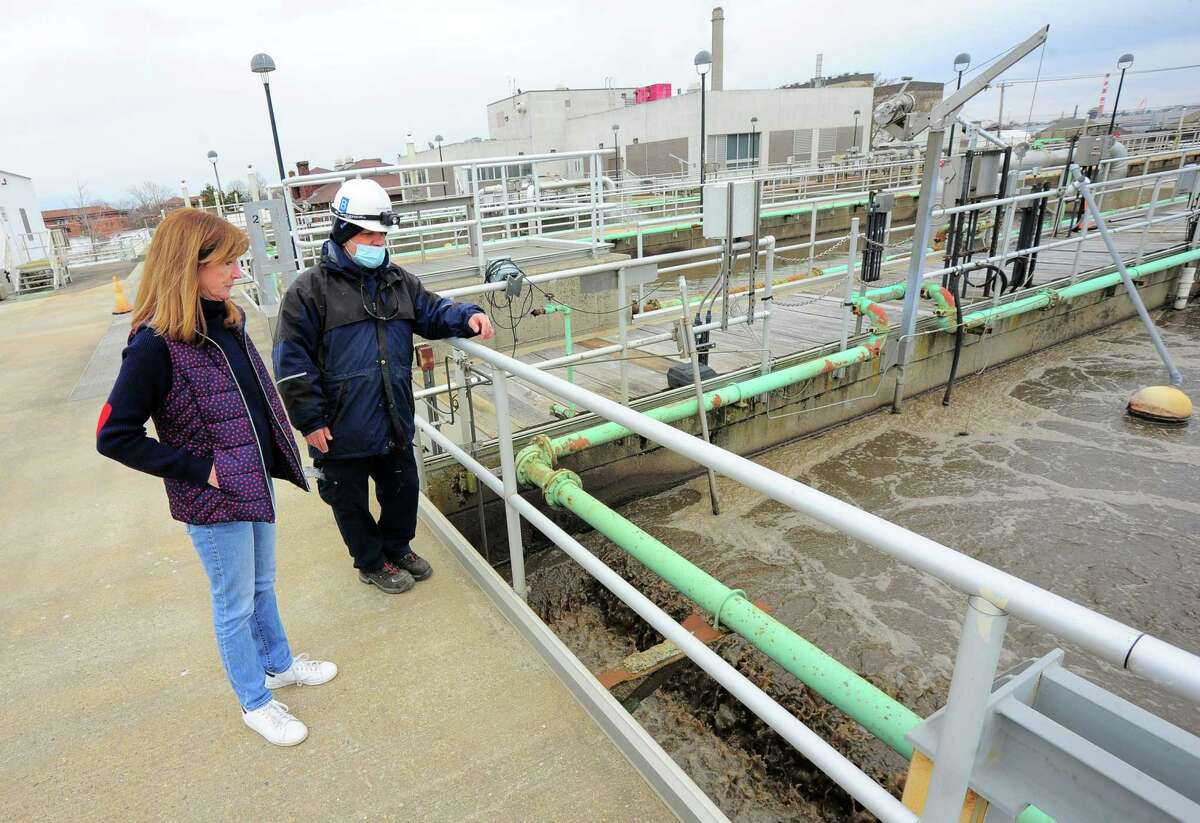 Water Pollution Control Authority General Manager Lauren Mappa, left, and Shift Supervisor Marcelo Borges inspect the facility in Bridgeport, Conn., on Tuesday Mar. 16, 2021. The city is moving ahead with long-needed, state-required upgrades of the its sewer/sewage treatment system.