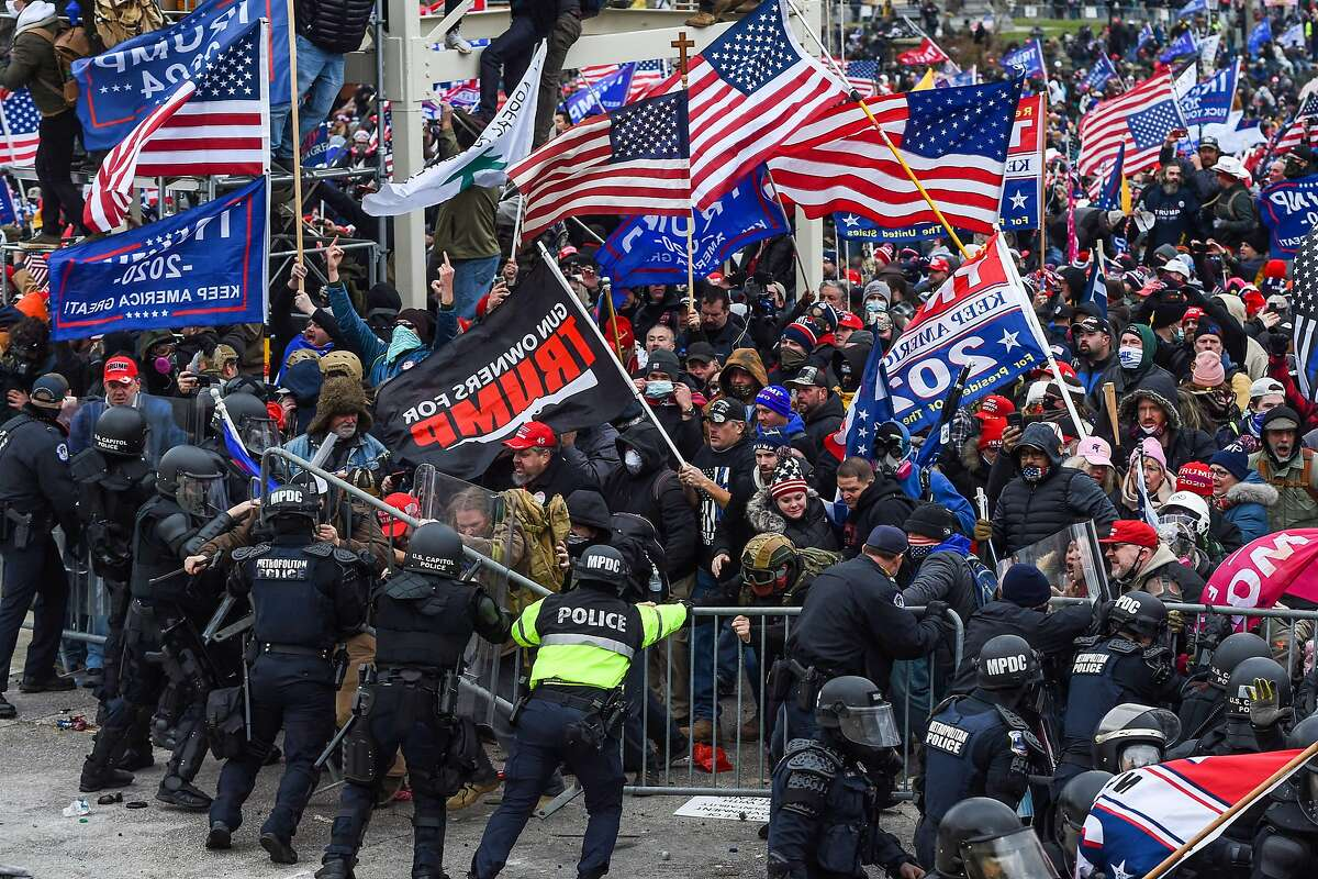 Trump supporters clash with police and security forces as they storm the U.S. Capitol in Washington, D.C, on Jan. 6, 2021. (ROBERTO SCHMIDT/AFP via Getty Images/TNS)