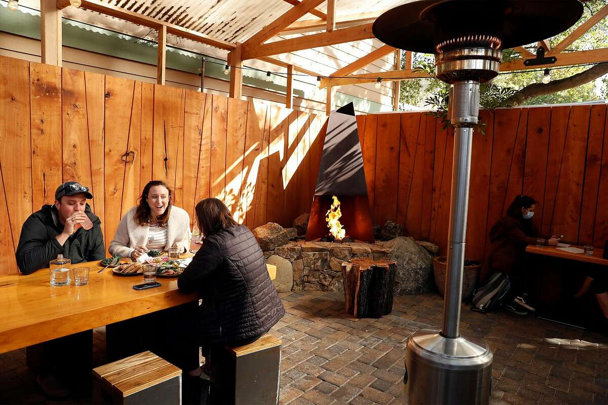 The back patio, heated with lamps and a fireplace, at Stillwater in Fairfax.